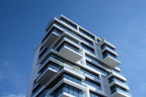 What is one-room management regulation? Explain the impact on real estate investment
